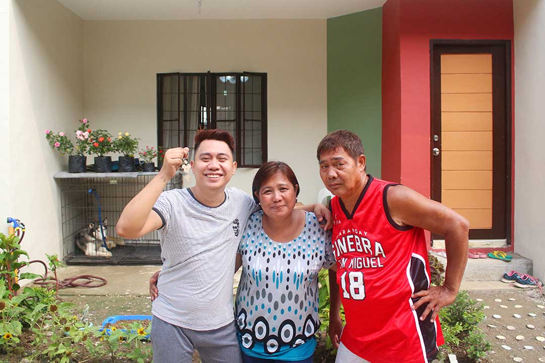 Photo showing Dominic Gonzales with parents in front of his new house at the Courtyards at Golden Horizon